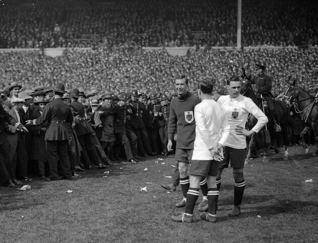 Cup Final, Wembley, 1923. Bolton Wanderers versus West Ham Unied. Late kick off...
