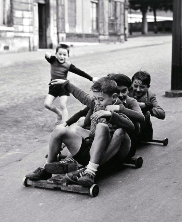 Sabine Weiss - Pushchairs, Carts And Casters. Children In Menilmontant, Paris, France ca. 1952.