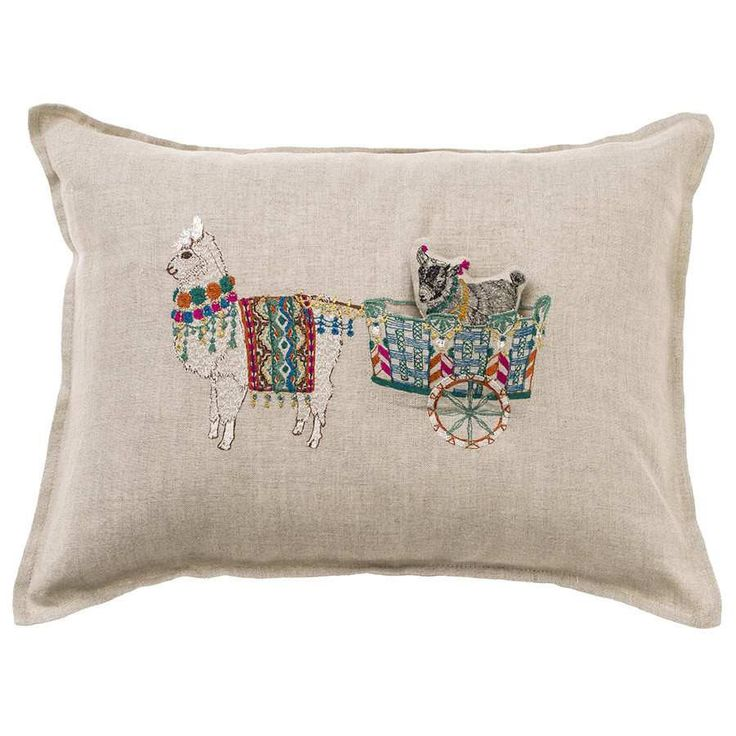 """Our goat pal is going for a ride and you're invited to come along! Hop aboard Alpaca's cart for a grand adventure. Pillow has a 90% small feather, 10% down insert. Embroidered cover on 100% natural linen fabric. Back fabric is 100% natural linen. Measures 12"""" x 16"""". Please see our detailedcareinstructionsin ourFAQs."""