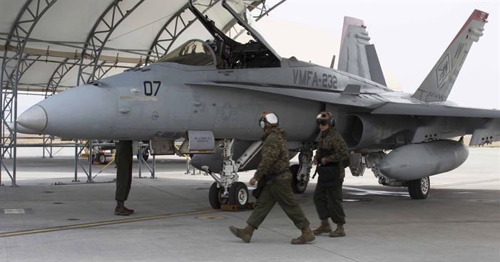 U.S. Marines with Marine Fighter Attack Squadron (VMFA) 232 prepare an F/A-18C Hornet aircraft for safe flight at Marine Corps Air Station (MCAS) Iwakuni, Japan, March 22, 2017. The squadron left MCAS Miramar, Calif., March 11, 2017 and arrived at MCAS Iwakuni March 15. The squadron is part of the Unit Deployment Program and helps provide air support to III Marine Expeditionary Force through training and combat operations. (U.S. Marine Corps photo by Lance Cpl. Gabriela Garcia-Herrera)