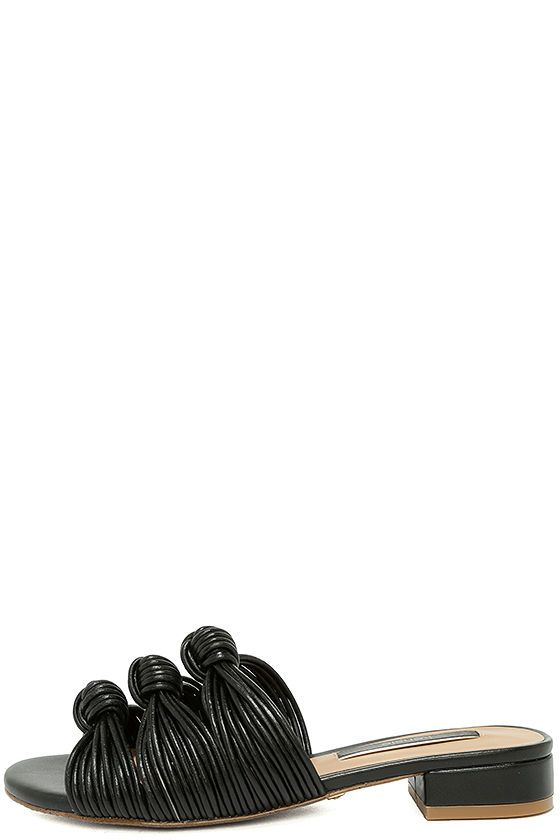 Our inner fashionista is rejoicing over the Kensie Kylee Black Knotted Slide Sandals! These oh, so chic vegan leather slides have a network of strands that are formed to cool knotted accents atop the peep-toe.