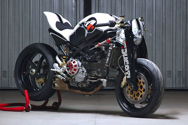 Italian automotive designer Paolo Tesio has reworked Ducati's iconic Monster into an even more desirable machine, transforming its looks with remarkably few modifications. After extensive CAD modeling, Tesi cut back the rear subframe, designed a new seat unit, and created girder-style fork guards to slip over the 43 mm adjustable Showa front suspension.
