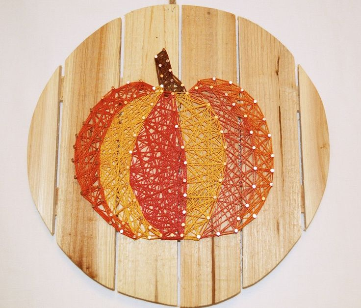 - A circular wooden plaque with rose gold nails and an array of autumn colored string bring this pumpkin to life! Twine loop for easy hanging. - This string art pumpkin is perfect for the fall season