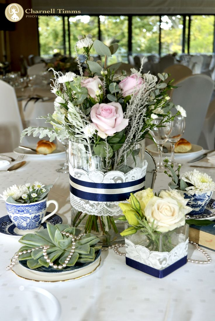 Unique table décor with flower springing out of bone china. Charnell Timms Photography