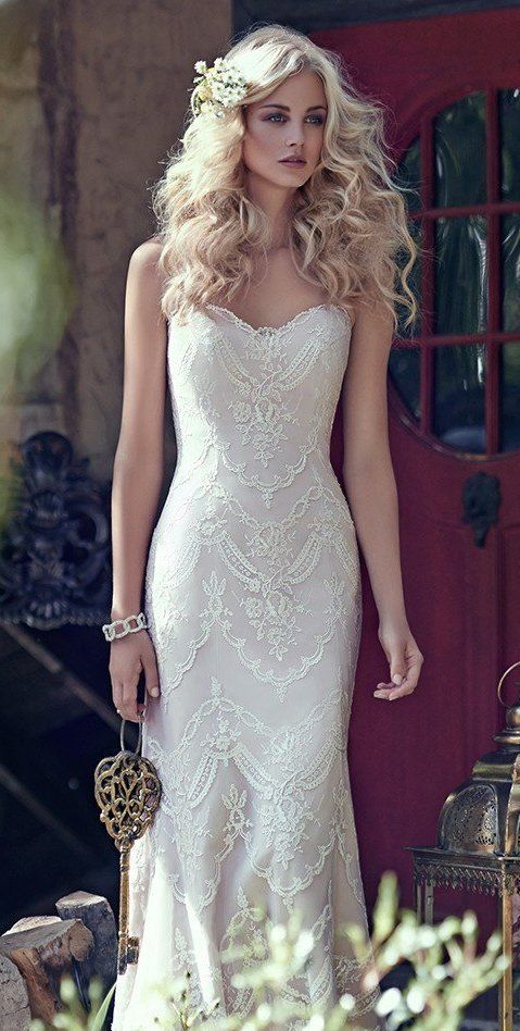 Maggie Sottero - KIRSTIE, Elegant lace appliqués drift atop tulle to create this breathtaking bohemian sheath wedding dress, with a timeless, romantic sweetheart neckline. Finished with covered buttons over zipper and inner corset closure. Find your dream dress at www.pinterest.com/laurenweds/wedding-dresses?utm_content=buffer637fd&utm_medium=social&utm_source=pinterest.com&utm_campaign=buffer