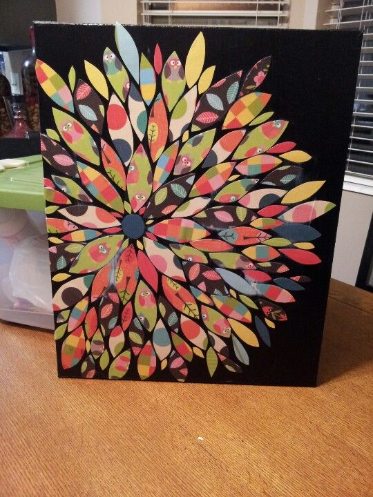 Do it yourself Wall Art! Canvas board, black acrylic paint, scrap book paper cut into various leaf shapesand mod podge. So easy! So fun!