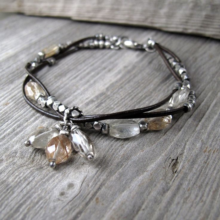 Intertwined leather & silver with rutilated quartz  . . . .   ღTrish W ~ http://www.pinterest.com/trishw/  . . . .  #handmade #jewelry #bracelet
