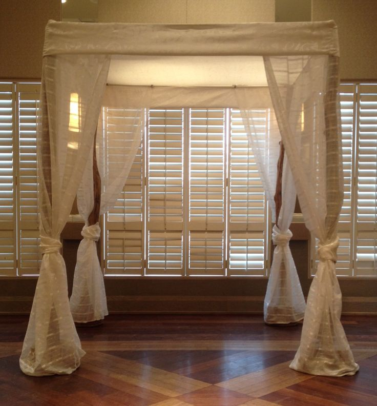 Modern Chuppah With Off White Satin Top And Drapes Over Maple Posts