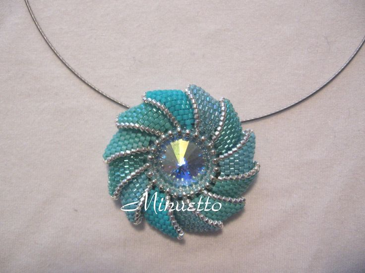 """""""Twister pendant"""". Instructions in Italian, mostly peyote.  Love the organic geometric effect."""