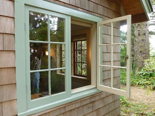 rehab with wood casement windows and wide sills on the