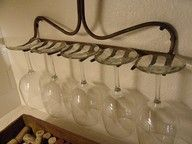 Wine rack out of old rake... clever!