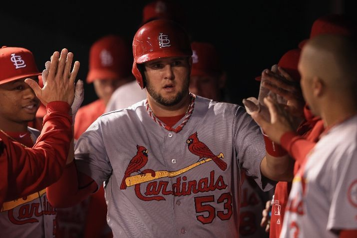 Matt Adams celebrates in the dugout after scoring on a single by David Freese to tie the score with the Rockies in the 5th inning. Cards lost the game 6-2.  9-16-13