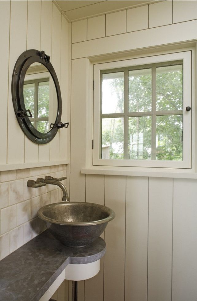 stainless steel vessel sink, wall mount faucet,porthole mirror, space saving shallow vanity, vertical wood plank walls,