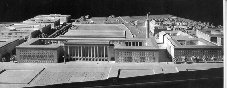 Návrh zo súťaže na riešenie vládnej štvrte na Námestí Slobody: Viedenčania Theiss a Jaksch okolo námestia navrhovali viackrídlové  klasicizujúce paláce v monumentálnom štýle Tretej ríše.