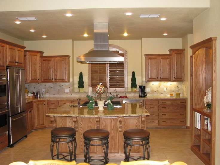 There are so few photos with oak trim and oak cabinets for White kitchen cabinets with oak trim