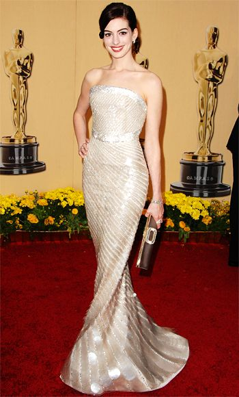 First-time nominee #AnneHathaway wasn't named Best Actress (for #RachelGettingMarried) at the 2009 #Oscar ceremony, but her stunning #Armani Prive gown won her a spot on everyone's best dressed list.  The dress, which was completely covered in mother of pearl paillettes, weighed roughly 15 pounds.  #AcademyAwards