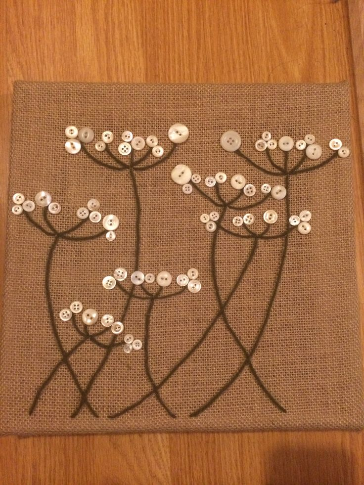 Art I created for my dorm room! Buttons and yarn on a burlap canvas.