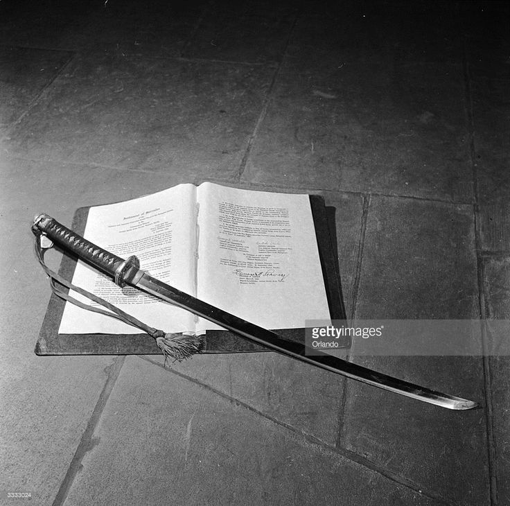 The samurai sword of General Tomoyuki Yamashita, 'the Tiger of Malaya', commander of the Japanese troops in the Philippines during World War II. It rests on the Philippine Surrender Document, signed at Baguio, Luzon on September 3rd, 1945.