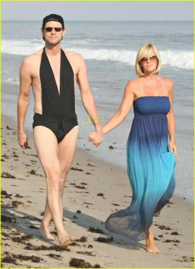 Can someone please explain why Jim Carey is in a women's swimsuit?!