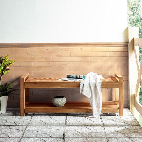 Made Of Naturally Weather Resistant Acacia Wood This Outdoor Bench Features A Lower Slat Sty In 2021 Wooden Storage Bench Wood Storage Bench Clearance Patio Furniture
