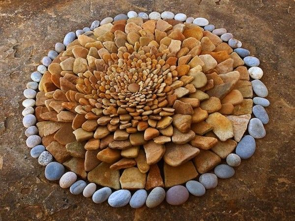 here, she layers it. It looks like flower petals and I find myself searching for the fibonacci spiral in the center