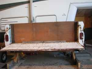 Tailgate flip down bench