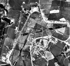 Portreath airfield in 1942. The runways are camouflaged and the lines of former field boundaries and a road have been painted over the grass areas of the airfield. © English Heritage (NMR) RAF Photography: FNO/27/6080