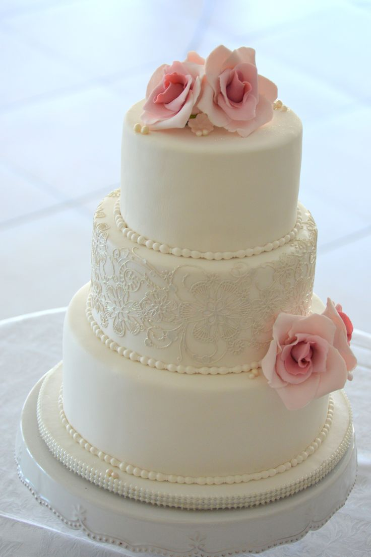 Blush pink wedding cake with lace details