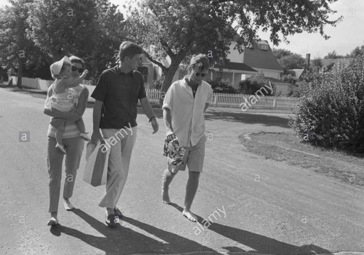 Have never seen this one before. Walking in Hyannis Port, Jackie holding Caroline, JFK and RFK.