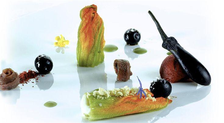 Fiori di Zucca con patate e acciughe, pomodoro confit farcito con melanzane mignon, olive dolci pugliesi