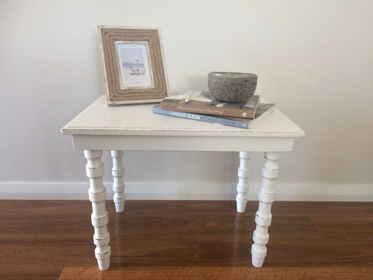 This was such a cute little side table that was in great need of repair! The best feature is the beautiful curved legs, that have now been distressed to add a lot of charm. The piece has been painted in a lovely warm white, which gives it a very modern feel. #furniture #handpainted #distressed #white #dulux #paint #sidetable