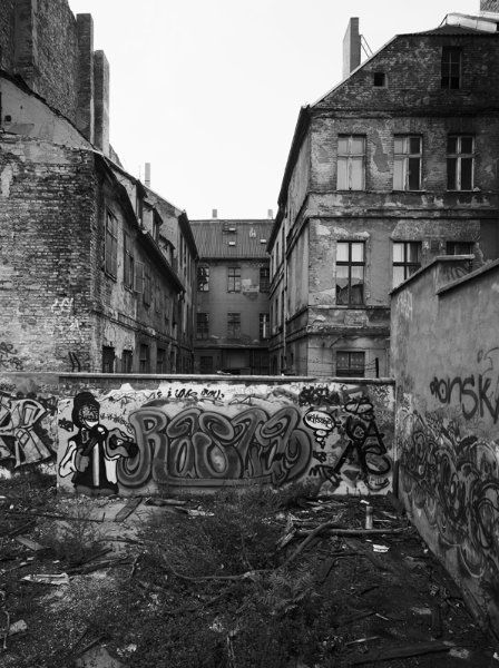 Behind the wall, 1992. The courtyard of this building on Marienstrasse in Berlin leads onto a train track viaduct.