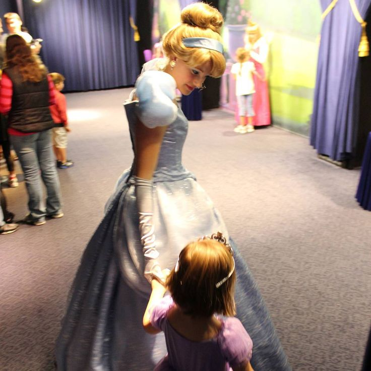 I love that I was able to capture this picture.  The Disney Photopass photographer got tied up quickly fixing their camera when it was our daughter's turn to go see Cinderella. And when Cinderella noticed that we weren't coming over she wandered over and escorted our girl in.  Luckily I was able to whip my camera up and grab a couple unique shots quickly.  The photo is maybe a bit blurry but it captures a great moment where a Disney cast member was able to make our daugher feel extra…