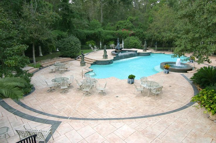 Surrounding the pool is a lovely stone patio customized to accommodate 10-person round banquet tables for large outdoor dinner parties or dozens of pool loungers, table and chairs to entertain family and friends.    MLS # 5384204  http://www.woodlandsrealtypros.com