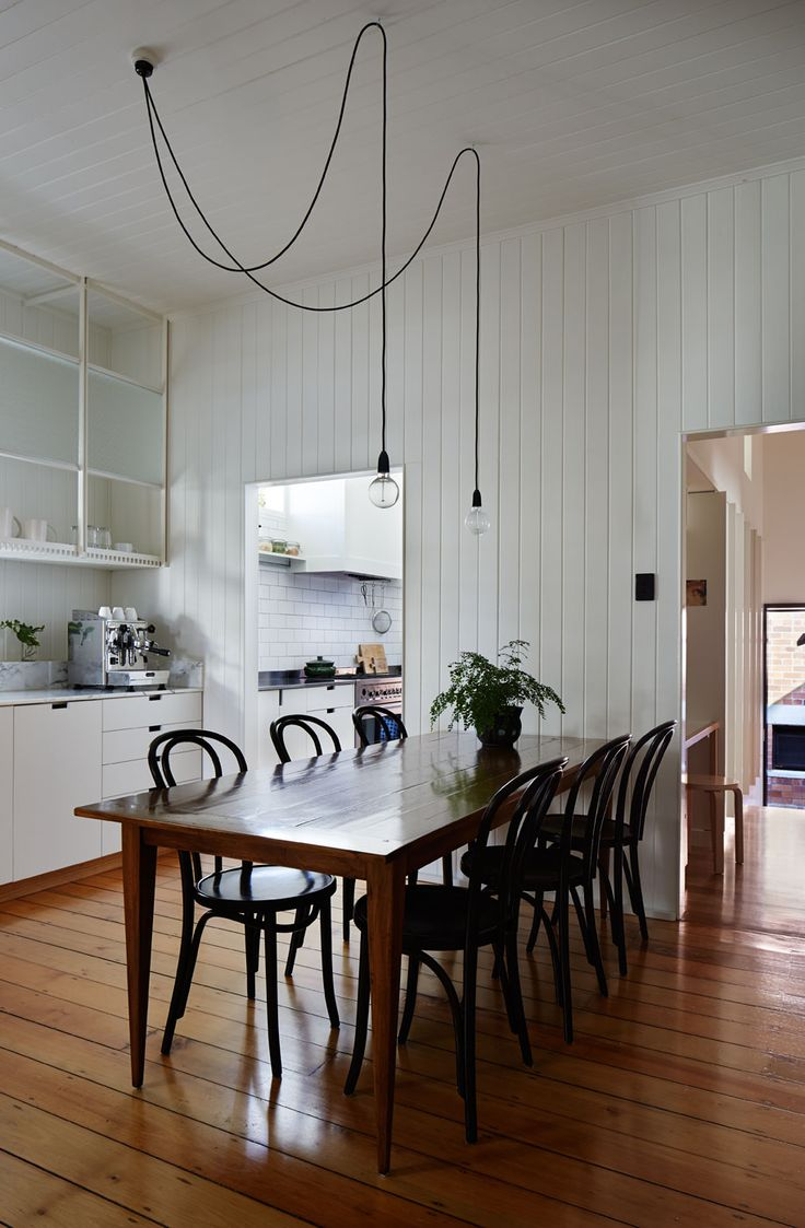 The kitchen here is broken into two sections - a servery section and a working section (tucked away from public view). Love the simple palette which lets the original features of the home shine. West End Cottage Renovation: A Photo Essay