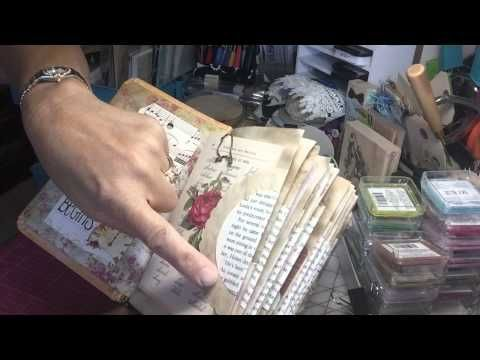 journal made with book with elastic , inside taken out . paper signatures attached with thread .