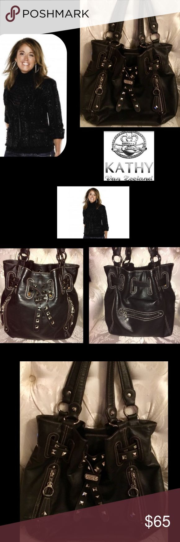 """🦋Kathy Van Zeeland 🖤Exotic Leather Stud Bag Silver grommets and tan stitching adorn this gorgeous,elegant black leather🖤satchel bag🖤3 compartments🖤first side has zip pocket🖤center zip pocket🖤third side has wall pockets for easy organization in the spacious bag2 front & one back zip pocket🖤logo hardware🖤magnetic & drawstring closure on this beauty🖤glam gold lining for sheer elegance🖤 14"""" W🖤16"""" H 🖤total drop 24"""" 🖤I used it to jet set a handful of times🖤pristine condition🖤very…"""
