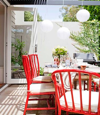 close up. love love loving the red (foxy chairs from Robert Plumb). Pergola - Dulux 'domino'