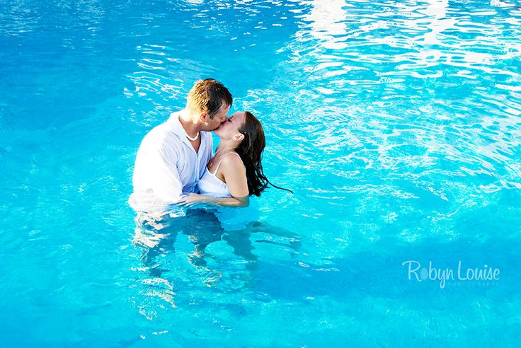 Trash the Dress in the pool at Grand Sunset Princess Playa Del Carmen, Mexico. | Robyn Louise Photography Quesnel, Williams Lake and Cariboo BC Engagement Photography Photographer. Available worldwide. Engagements | Robyn Louise Photography www.robynlouise.com Engagements | Robyn Louise Photography Trash the Dress | Robyn Louise Photography