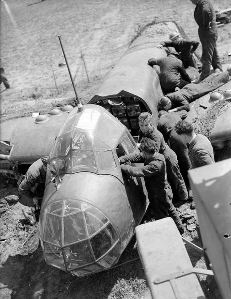 Allied salvage crews dismantle a German Junkers Ju 88, brought down during the the Luftwaffe's attacks on RAF airfields in France, between 10-12 May 1940.