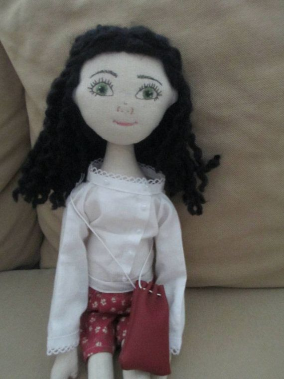 Check out this item in my Etsy shop https://www.etsy.com/listing/234601690/handmade-fabric-doll-with-embroidered