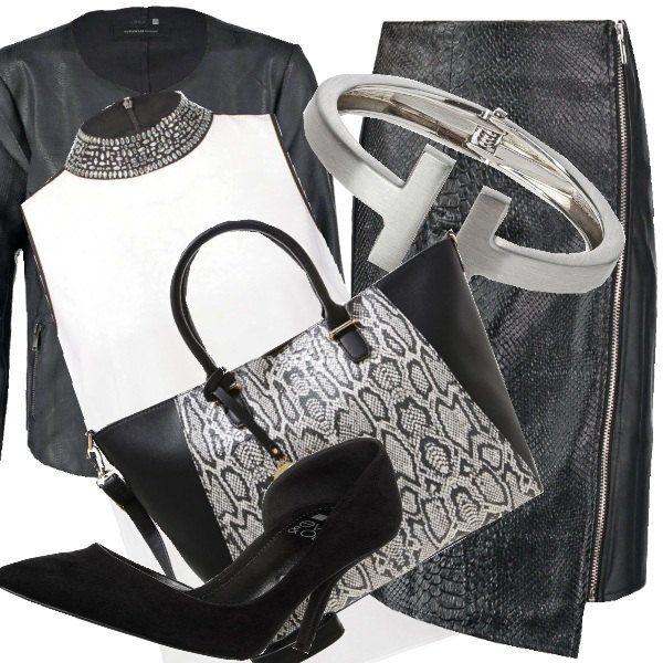 Uno stile elegante con il tubino con cerniera sul davanti. Il top bianco incorniciato dal colletto prezioso. In abbinamento una giacca nera in finta pelle e la borsa che riprende i toni del nero e dell'argento. Per finire un bracciale avvolgente che illumina il look.