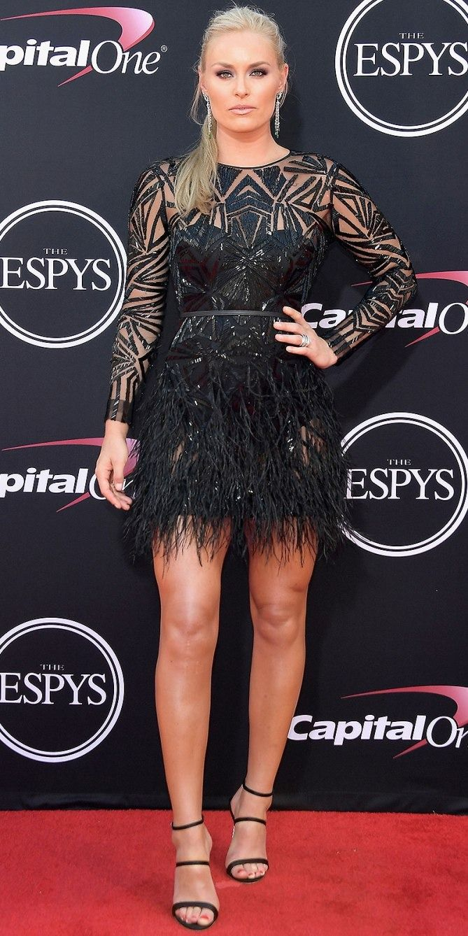 Lindsey Vonn in a sheer black feather Monique Lhuillier mini dress