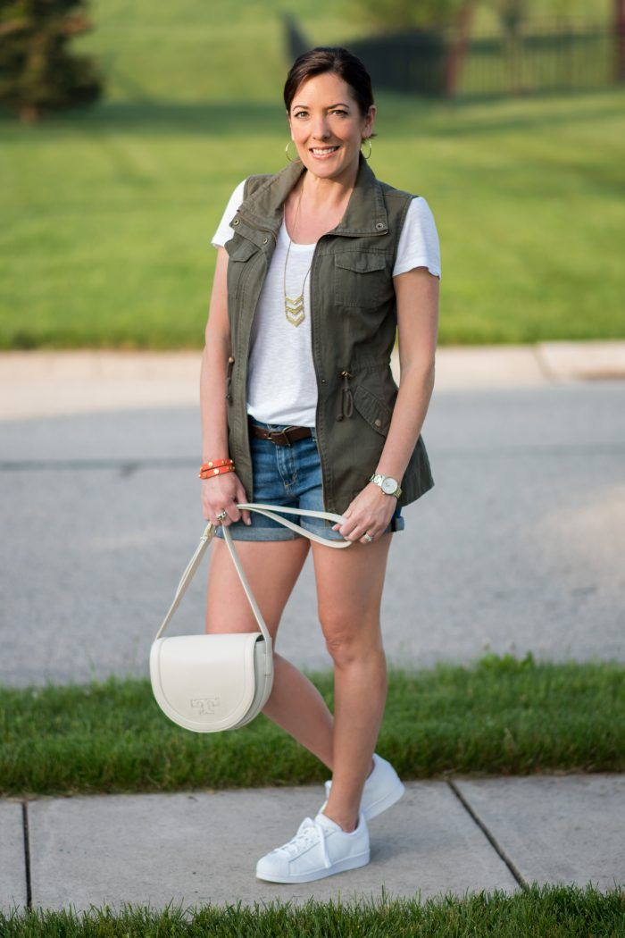 how to style a utility vest for summer: rolled hem denim shorts with white  tee