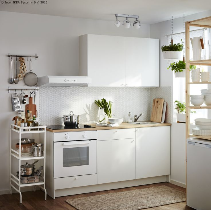 A Small White Kitchen Consisting Of A Complete Base Cabinet With Doors,  Drawers, Worktop And A Wall Cabinet With Doors. Combined With A White Wall  Mounted ... Part 74