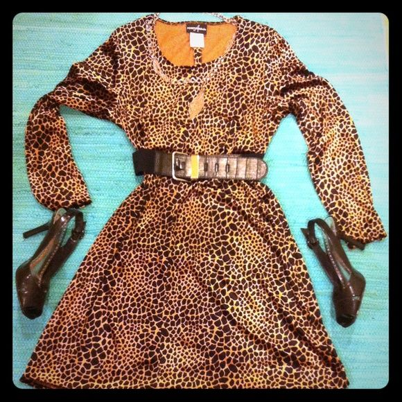 "HP 2/8/16  Retro Animal Print Dress/Tunic Top Trends Party HP 2/8/16 This Dress can be worn as a Tunic too. Is over the Knee on me, 5'9"". Belt is not included. 75% Rayon/25% Polyester. Very Shiny so it looks like Velour. Label says Size 16, but will fit anyone who wears a Large. Very Good Condition. No Trades. The Black Patent Leather Slingbacks are listed separately. Positive Attitude Dresses Long Sleeve"
