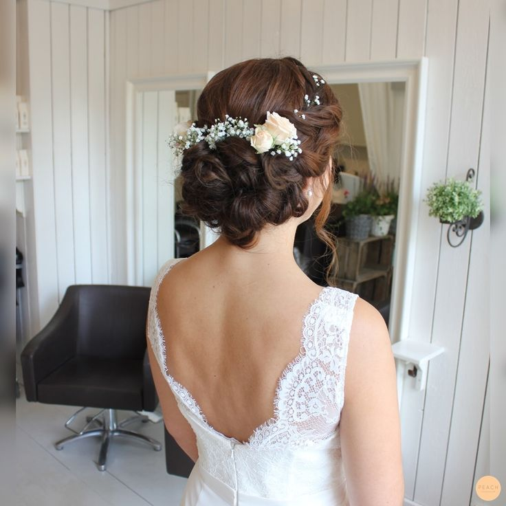 romantic bridal hairdo with flowers