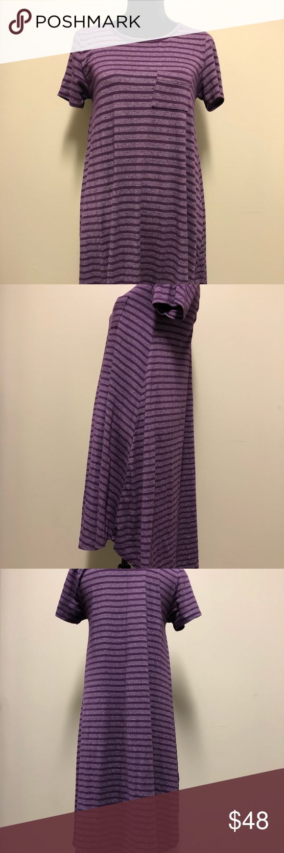 """LuLaRoe Purple Carly Dress Size XS LuLaRoe Purple Carly Dress   Size XS  Made in Mexico  64% cotton 32% polyester 4% spandex  16"""" armpit to armpit  2"""" armpit to end of sleeve 35"""" length  Check out the other items in my closet! ✨💫 LuLaRoe Dresses High Low"""
