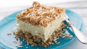 The tropical beach vacation version of our classic crunch cake. Toasted coconut is mixed into a crunchy, buttery granola bar streusel, then sandwiched around a creamy coconut-pineapple filling. Grab your tiny umbrellas—this dessert is worth the indulgence!