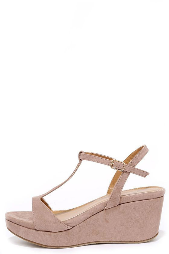 We can't stop talking about the latest local celeb ... the Islander Nude Suede Platform Wedge Sandals! These newsworthy wedges have a soft vegan suede design that covers a peep toe, T-strap, and quarter strap with adjustable gold buckle.